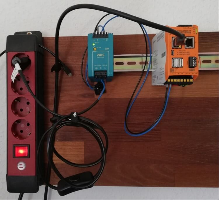 Board for RevPi assembly including multiple sockets and power supply